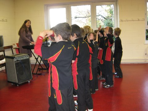 Pupils rehearse for Christmas Concert with Ms Ruth O'Shea