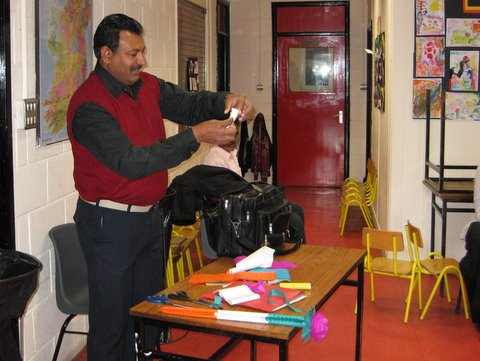 Mr Rajender Singh gives a demonstration of Paper Craft