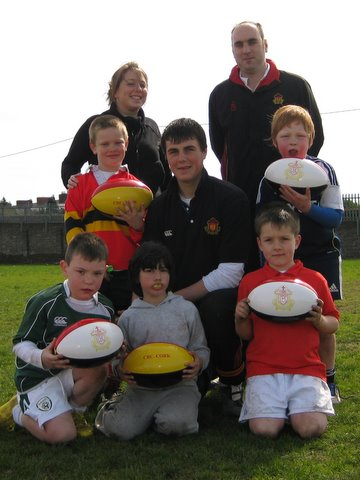 Prep School Teachers Ms Sharon McAdoo and Mr Steven Lynch with some of the younger rugby players