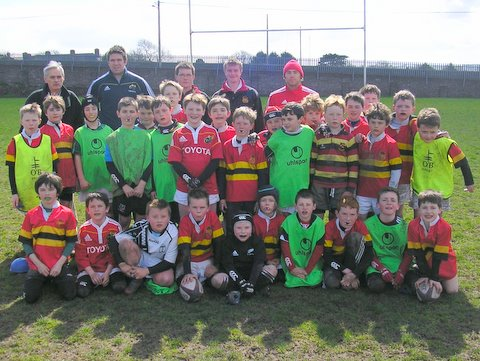 Principal Dr Larry Jordan and Munster Players Billy Holland and Duncan Williams visit th camp