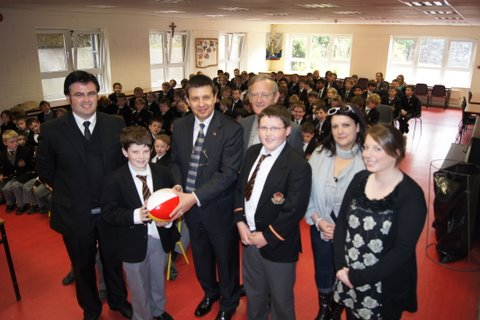 Roy O'Mahony presents the Ambassador with a CBC rugby ball.