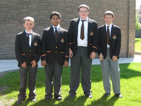 The Chess Team: Paddy f rom Fourth, Saltanat from Fifth, Conor and Billy from Sixth