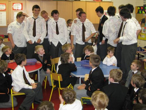 Junior Infants are delighted to see some of the Sixth Year boys on their last day in school.  Many started in the Prep School fourteen years ago.