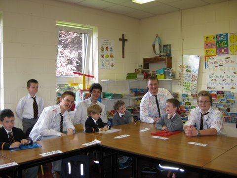 Contrast! Sixth Class boys sit down with Senior Infants!