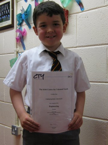 Tadhg Quill-Manley of First Class with his certificate