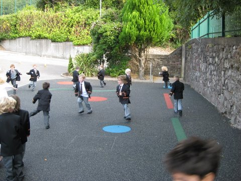 Junior Infants run on the new cushioned yard surface