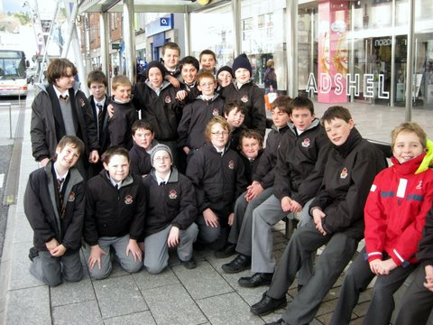 Sixth Class wait for the bus at Patrick's Street bus shelter