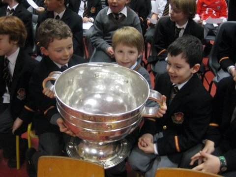 Sam Maguire is passed round so everybody gets a turn to hold it.