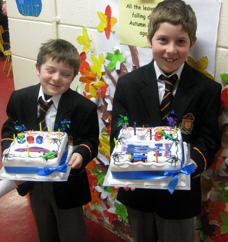 Charlie and Tom Healy with their birthday cakes.
