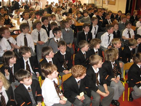 The pupils wait anxiously for Rachel Sarah to pick the winning ticket in the Easter Egg draw