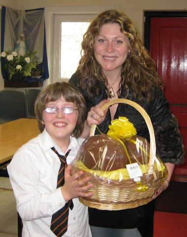 Rachel Sarah presents the Easter Egg to the lucky winner