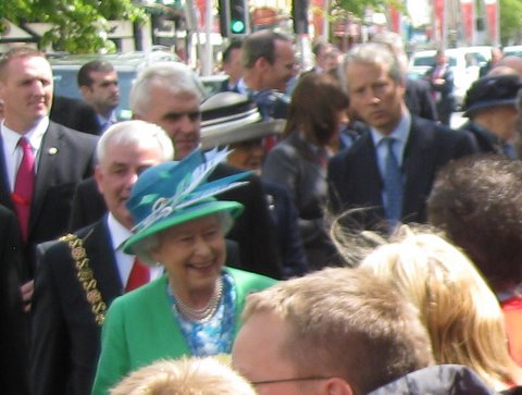 The Queen passes by, pausing briefly to talk to Prep School boys