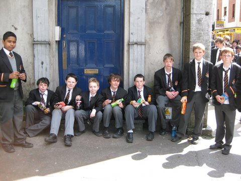 The Prep School boys wait for barriers to be lifted after the royal visit