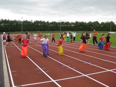 Sack race contestants near the finishing line.